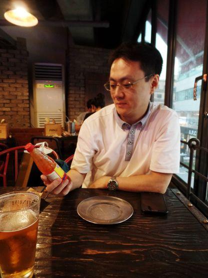 Phil inspecting the Louisiana Hot Sauce