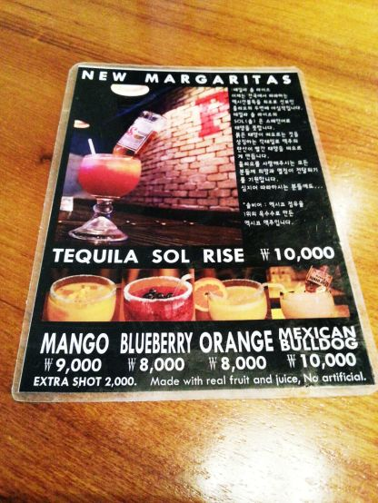 A huge menu plus a frozen margarita menu.
