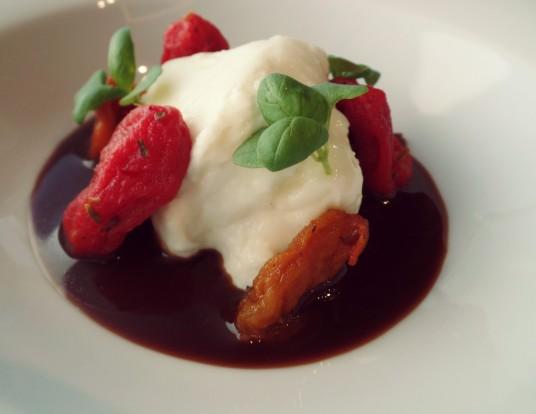 Burrata Cheese, Grilled Tomato, Basil. Similar to a Caprese salad.